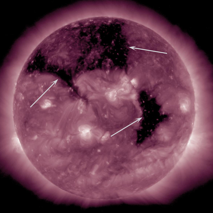 Coronal_holes_AIA211_arrows.jpg